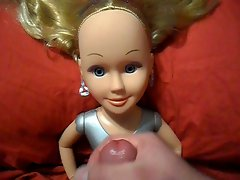 Sexy Blonde Doll Takes a Facial Cumshot