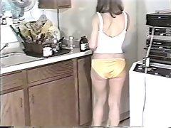 Girl wearing Nylon Panties in kitchen