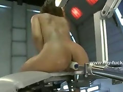 Goddess in black high heels has her pussy fucked by a machine while her ass is abused