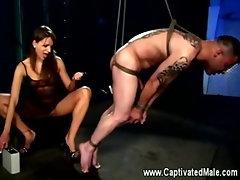 Dominatrix loves flogging her slaves