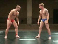 Horny men wrestling each other