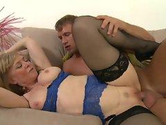 Mature babe Nina Hartley bounces on a lucky guy's pole