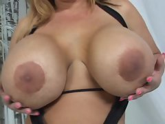 Crystal Storm lets her big tits hang while she is being fucked