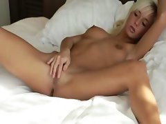 Blonde woman spreads pink pussy