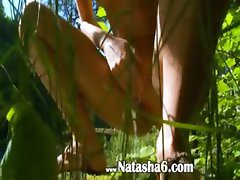 Petite latvian chick peeing in a forest