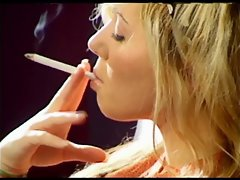 LOVELY BLONDE WITH LONGNAILS SMOKING