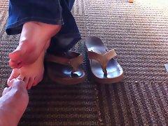 hidden footsie in library with unknown women