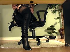 Secretary with boots under desk masturbation