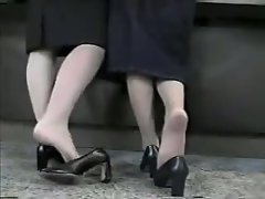 Candid Shoeplay - 2 hostess dipping heels