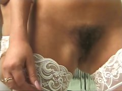 Two hot sluts show off their tight ass holes in front of mirror