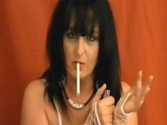 Mature brunette smoking and playing