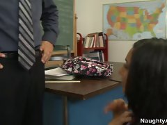 School girl fucks her teacher on the desk in the classroom