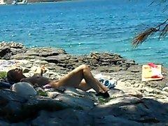 older lady naked on nudist beach