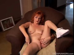 Gorgeous ginger cougar talks dirty and fucks her wet pussy