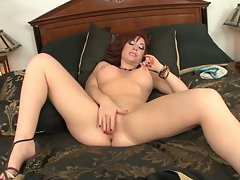 Horny milf touching her pussy for all the world to see