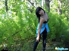 Sexy brunette teen strips in the woods