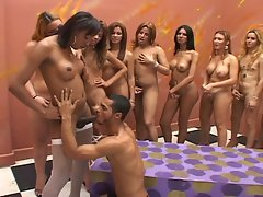 Ten horny shemales get their cocks sucked by one eager latino