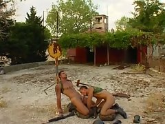 Two horny muscled soldiers suck cock outside