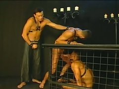 Dungeon threesome as hunks cum in cages