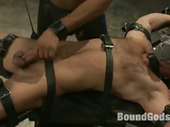 Horny gay hunk tortured by his abusive master