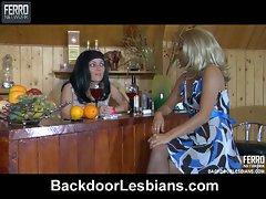 Lesbian babes love dildo fucking at the bar