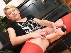 Horny blonde momma in red stockings takes it double