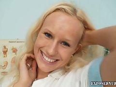 Nurse babe Vendula exposes her pussy