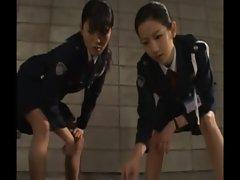 Slutty police sluts give their suspect a handjob as punishment