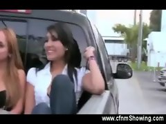 Curious girls jerk off a guy in the back of a pick up