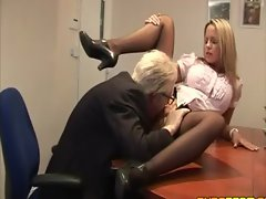 Classy clothed secretary seduces her boss
