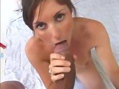 Cute brunette with perky tits sucks big dick