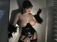 Asian with big boobs poses in a corset