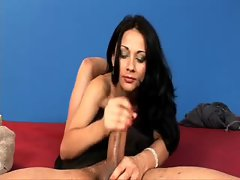 Handjob from a glamorous beauty in stockings