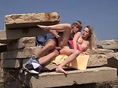 Sex outdoors on a pile of rocks