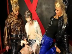 Classy clothed lesbians play with plastic cocks and get bukkake