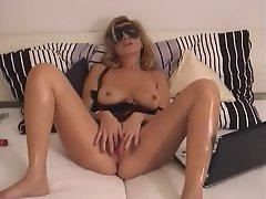 A hot masked milf masturbates her sexy pussy