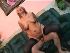 A sexy mature in boots and stockings nailed