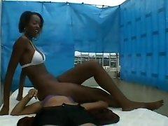 Black bikini babe facesitting on white babe