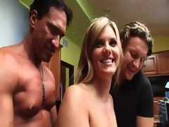 Horny dudes groping her boobs