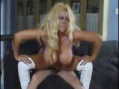 Busty blonde rides cock and kisses her man