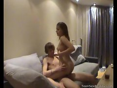 Teen rides her man's thick cock