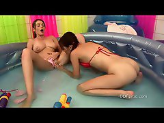 Two teens in the inflatable pool having fun together