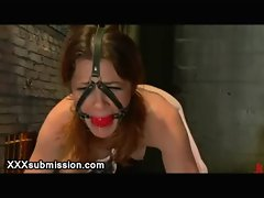 Bound babe hard feet flogged on bondage table