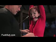Bondaged sexy redhead fucked in anus