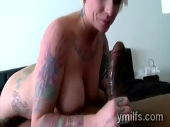 Awesome mature blonde whore Monroe Valentino sucks big black cock
