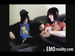 Shy emo teenager kissing his friends prick over his underwear