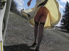 Sissy Ray outdoors on windy day gold dress