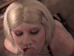 Vintage Carli in leather getting facial from a white chap