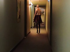 Sissy Ray in Hotel Corridor in Purple Maids Uniform