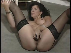 English whore Gilly plays with herself in various episodes